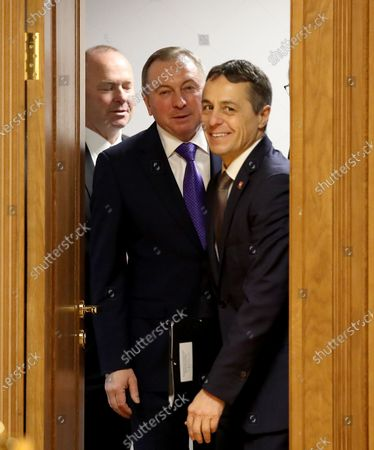Swiss Federal Councillor and Foreign Minister Ignazio Cassis (R) walks with Belarussian Foreign Minister Vladimir Makei (C) during their meeting in Minsk, Belarus, 13 February 2020. Ignazio Cassis is on his visit in Belarus for the official opening of a Swiss embassy.