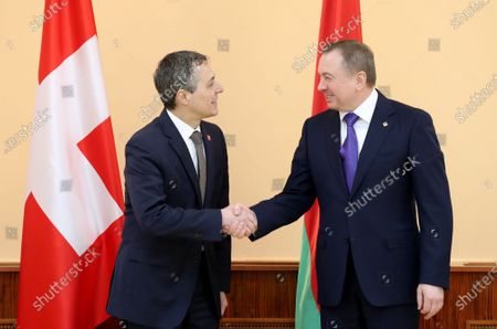 Swiss Federal Councillor and Foreign Minister Ignazio Cassis (L) and Belarussian Foreign Minister Vladimir Makei (R) shake hands during their meeting in Minsk, Belarus, 13 February 2020. Ignazio Cassis is on his visit in Belarus for the official opening of a Swiss embassy.