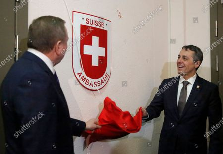 Swiss Federal Councillor and Foreign Minister Ignazio Cassis (R) with Belarusian Foreign Minister Vladimir Makei (L) remove a cloth from a new nameplate of a Swiss embassy during the opening ceremony of a Swiss embassy in Minsk, Belarus, 13 February 2020. Ignazio Cassis is on his visit in Belarus, during which a Swiss embassy will be opened.