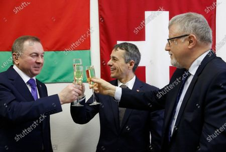 Swiss Federal Councillor and Foreign Minister Ignazio Cassis (C) toasts with Belarusian Foreign Minister Vladimir Makei (L) and Claude Altermatt (R) head of the Office of the Embassy of Switzerland in Minsk during the opening ceremony of a Swiss embassy in Minsk, Belarus, 13 February 2020. Ignazio Cassis is on his visit in Belarus, during which a Swiss embassy will be opened.