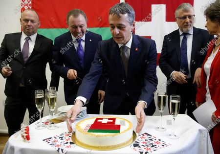 Swiss Federal Councillor and Foreign Minister Ignazio Cassis (C) cuts a cake with Belarusian Foreign Minister Vladimir Makei (2-L) and Claude Altermatt (2-R) head of the Office of the Embassy of Switzerland in Minsk during the opening ceremony of a Swiss embassy in Minsk, Belarus, 13 February 2020. Ignazio Cassis is on his visit in Belarus, during which a Swiss embassy will be opened.