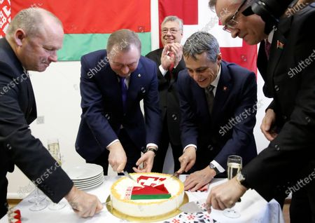 Swiss Federal Councillor and Foreign Minister Ignazio Cassis (C) cuts a cake with Belarusian Foreign Minister Vladimir Makei (2-L) and Claude Altermatt (2-R) head of the Office of the Embassy of Switzerland in Minsk during the opening ceremony of a Swiss embassy in Minsk, Belarus, 13 February 2020. Ignazio Cassis is on his visit in Belarus, during which a Swiss embassy will be opened. Others in image are unidentified.