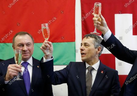 Swiss Federal Councillor and Foreign Minister Ignazio Cassis (R) cheers with Belarusian Foreign Minister Vladimir Makei (L)  during the opening ceremony of the Swiss embassy in Minsk, Belarus, 13 February 2020. Ignazio Cassis is on his visit in Belarus, during which a Swiss embassy will be opened.