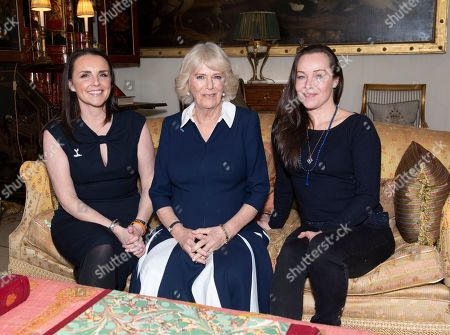 Camilla Duchess of Cornwall talks with SafeLives pioneers Celia Peachey (left) and Rachel Williams during a reception at Clarence House