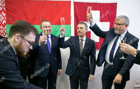 Stock Picture of Swiss Foreign Minister Ignazio Cassis, center, Swiss Ambassador to Belarus Claude Altermatt, right, and Belarus Foreign Minister Vladimir Makei, second left, toast as they attend an opening ceremony of the new Switzerland Embassy in Minsk, Belarus