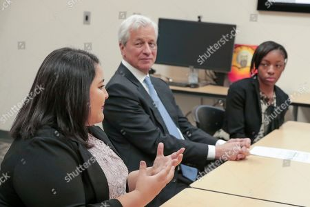 Stock Image of Jamie Dimon, Sharon Avina-Nunez. IMAGE DISTRIBUTED FOR JPMORGAN CHASE & CO - Chairman and CEO of JPMorgan Chase, Jamie Dimon speaking with Pinnacle Assurance apprentices before the launch of a multimillion-dollar career readiness investment from J Morgan Chase. From left: Apprentice Angela Mendoza-Rico, Chairman and CEO of JP Morgan Chase; Jamie Dimon, and Apprentice Sharon Avina-Nunez on . Denver is one of 10 global cities receiving the investment from JPMorgan Chase