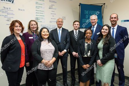 Jamie Dimon, Cheyanne Greer, Julie Wilmes, Angela Mendoza-Rico, Moniqw Lane, Phil Kalin, Sharon Avina-Nunez, Mark Tapy. IMAGE DISTRIBUTED FOR JPMORGAN CHASE & CO - Chairman and CEO of JPMorgan Chase, Jamie Dimon with Pinnocol Assurane apprentices and program leads before the launch of a multimillion-dollar career readiness investment on in Denver. Denver is one of 10 global cities receiving the investment from JPMorgan Chase. From left: Cheyanne Greer; Julie Wilmes; Apprentice Angela Mendoza-Rico; Chairman and CEO of JP Morgan Chase Jamie Dimon; Apprentice Eric Miller; Apprentice Moniqe Lane; Phil Kalin, President and CEO, Pinnacol Assurance; Apprentice Sharon Avina-Nunez and Mark Tapy