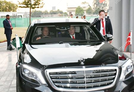Stock Photo of Imran Khan, Recep Tayyip Erdogan. In this photo released by the Press Information Department, Pakistan's Prime Minister Imran Khan, left, drives visiting Turkey's President Recep Tayyip Erdogan from Nur Khan base to a prime ministry house in Islamabad, Pakistan, . Erdogan is no a two-day visit to Pakistan