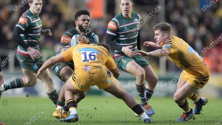 Leicester's Kyle Eastmond  braces as he is about to be tackled by Wasps' Gabriel Oghre (16)