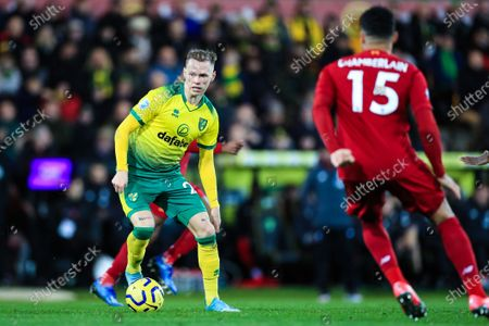 Stock Picture of 15th February 2020, Carrow Road, Norwich, England; Premier League, Norwich City v Liverpool : Ondrej Duda (25) of Norwich City tries to find a way passed Alex Oxlade-Chamberlain (15) of Liverpool