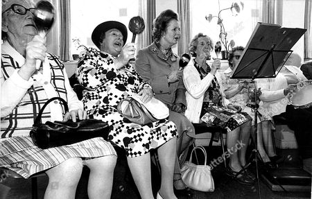 Stock Picture of Margaret Thatcher Pm 1980 Mrs Margaret Thatcher With Miss Jesse Taylor 61 (left) And Mrs Deborah Vincent (75) Pictured With Thatcher Playing Marracus.