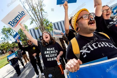 Students and supporters of Democratic presidential candidate Sen. Bernie Sanders hold placards and chant slogans during Bernie 2020 California College Tour. The event featured national surrogates Phillip Agnew and Xiuhtezcatl Martinez.