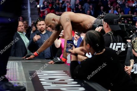 Jon Jones crawls into the ring before a light heavyweight mixed martial arts bout against Dominick Reyes at UFC 247, in Houston