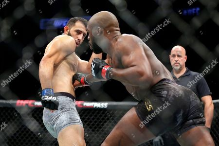 Dominick Reyes, left, and Jon Jones, right, during a light heavyweight mixed martial arts bout at UFC 247, in Houston