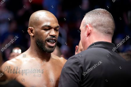 Jon Jones show his mouth guard with a bible verse as he goes through his pre-fight check before a light heavyweight mixed martial arts bout against Dominick Reyes at UFC 247, in Houston