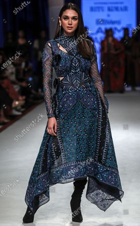 Bollywood actress Aditi Rao Hydari presents a creation by Indian designer Ritu Kumar during the Lakme Fashion Week (LFW) Summer/Resort 2020 in Mumbai, India, 13 February 2020.