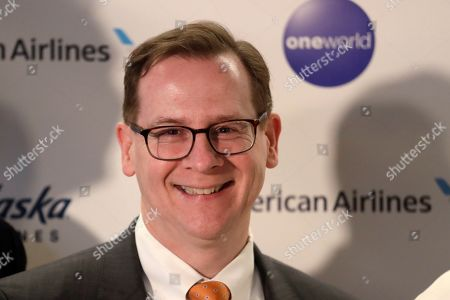 Andrew Harrison, Executive Vice President and Chief Commercial Officer of Alaska Airlines, poses for a photo after a news conference, in Seattle