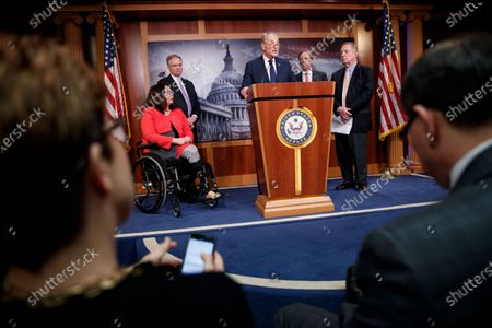 Senate Minority Leader Chuck Schumer (C), with Democratic Senator from Illinois Tammy Duckworth (R), Democratic Senator from Virginia Tim Kaine (2-L), Democratic Senator from New Mexico Tom Udall (2-R) and Senate Democratic Whip Dick Durbin (R), delivers remarks on the War Powers Resolution during a press conference in the US Capitol in Washington, DC, USA, 13 February 2020. The Senate approved, with a 55-45 bipartisan vote, a resolution to limit President Donald J. Trump's authority to launch military strikes against Iran.