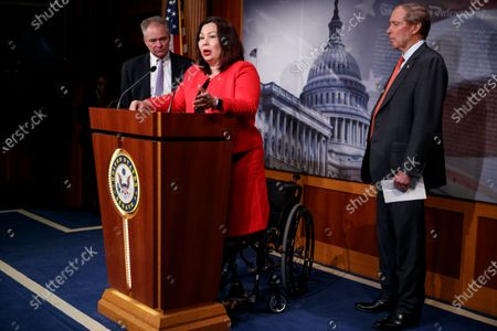 Democratic Senator from Illinois Tammy Duckworth (C),  with Democratic Senator from New Mexico Tom Udall (R) and Democratic Senator from Virginia Tim Kaine (L), delivers remarks on the War Powers Resolution during a press conference in the US Capitol in Washington, DC, USA, 13 February 2020. The Senate approved, with a 55-45 bipartisan vote, a resolution to limit President Donald J. Trump's authority to launch military strikes against Iran.