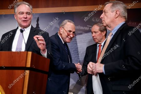 Senate Minority Leader Chuck Schumer (2-L) shakes with Democratic Senator from New Mexico Tom Udall (2-R), as Senate Democratic Whip Dick Durbin (R) listens to Democratic Senator from Virginia Tim Kaine (L) deliver remarks on the War Powers Resolution during a press conference in the US Capitol in Washington, DC, USA, 13 February 2020. The Senate approved, with a 55-45 bipartisan vote, a resolution to limit President Donald J. Trump's authority to launch military strikes against Iran.