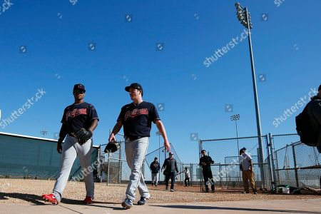 Stock Photo of Cleveland Indians pitchers Jared Robinson, left, and Jordan Stephens walk together to their pitching session during spring training baseball workouts for pitchers and catchers, in Avondale, Ariz