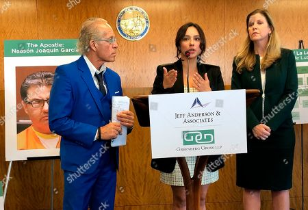 Sochil Martin, center, with lawyers Jeff Anderson, left, and Deborah Mallgrave, speaks at a news conference in Los Angeles . Martin has filed a federal lawsuit claiming that the leaders of Mexican megachurch La Luz del Mundo sexually abused her since she was 12 years old