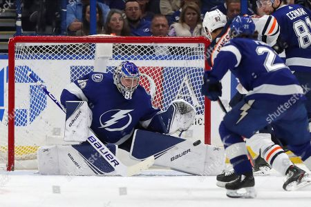 Edmonton Oilers' Caleb Jones scores past Tampa Bay Lightning goaltender Andrei Vasilevskiy, of Russia, during the second period of an NHL hockey game, in Tampa, Fla