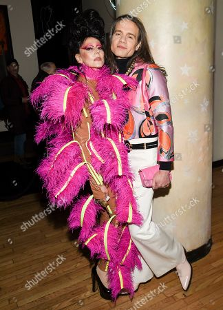 """Stock Picture of Susanne Bartsch, Jordan Roth. Event planner Susanne Bartsch, left, and Broadway producer Jordan Roth pose together at a special screening of """"The Times of Bill Cunningham"""", hosted by MAC, Nordstrom and the CFDA, at the Angelika Film Center, in New York"""