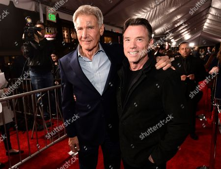 """Stock Photo of Harrison Ford, Terry Notary. Harrison Ford, left, a cast member in """"The Call of the Wild,"""" poses with Terry Notary at the premiere of the film at the El Capitan Theatre, in Los Angeles"""