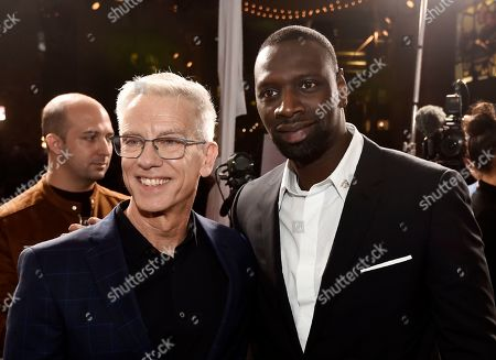 """Chris Sanders, Omar Sy. Chris Sanders, left, director of """"The Call of the Wild,"""" poses with cast member Omar Sy at the premiere of the film at the El Capitan Theatre, in Los Angeles"""
