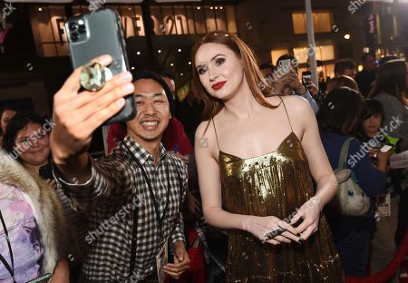 "Karen Gillan, a cast member in ""The Call of the Wild,"" poses for a photo with a fan at the premiere of the film at the El Capitan Theatre, in Los Angeles"