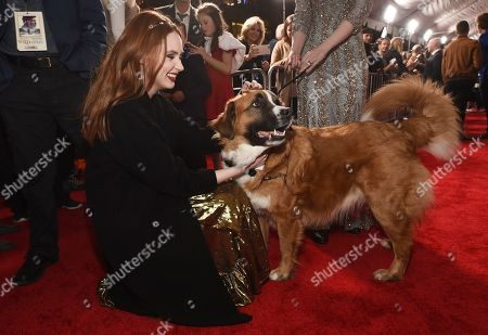 "Karen Gillan, a cast member in ""The Call of the Wild,"" pets ""Buckley,"" the St. Bernard mix upon whom the film's digital canine character is based, at the premiere of the film at the El Capitan Theatre, in Los Angeles"