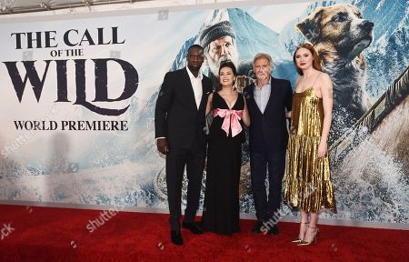 "Omar Sy, Cara Gee, Harrison Ford, Karen Gillan. From left, Omar Sy, Cara Gee, Harrison Ford and Karen Gillan, cast members in ""The Call of the Wild,"" pose together at the premiere of the film at the El Capitan Theatre, in Los Angeles"