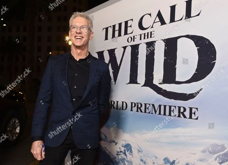 """Chris Sanders, director of """"The Call of the Wild,"""" poses at the premiere of the film at the El Capitan Theatre, in Los Angeles"""