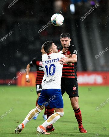 15th February 2020; Bankwest Stadium, Parramatta, New South Wales, Australia, Australian A League football, Western Sydney Wanderers versus Newcastle Jets; Dimitri Petratos of Newcastle Jets and Dylan McGowan of Western Sydney Wanderers compete for a high ball