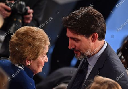 Former US secretary of state Madeleine Albright (L) and Canadian Prime Minister Justin Trudeau (R) talk after the panel discussion 'Westlessness in the West: What Are We Defending?' at the 56th Munich Security Conference (MSC) in Munich, Germany, 14 February 2020. More than 500 high-level international decision-makers meet at the 56th Munich Security Conference in Munich during their annual meeting from 14 to 16 February 2020 to discuss global security issues.
