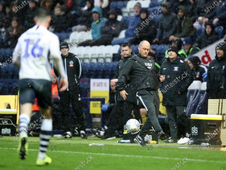 15th February 2020; Deepdale Stadium, Preston, Lancashire, England; Championship Football, Preston North End versus Millwall; Preston North End manager Alex Neill  controls a stray ball as it lands in the technical area