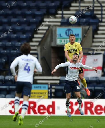 15th February 2020; Deepdale Stadium, Preston, Lancashire, England; Championship Football, Preston North End versus Millwall; Shaun Hutchinson of Millwall leaps above David Nugent of Preston North End to win a header