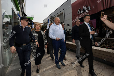 Avigdor Lieberman, center, leader of the Yisrael Beiteinu, party, walks during election campaign tour in a shopping mall in the Port city of Ashdod, Israel