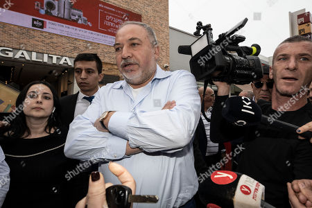 Avigdor Lieberman, center, leader of the Yisrael Beiteinu, party, meets people during election campaign tour in a shopping mall in the Port city of Ashdod, Israel