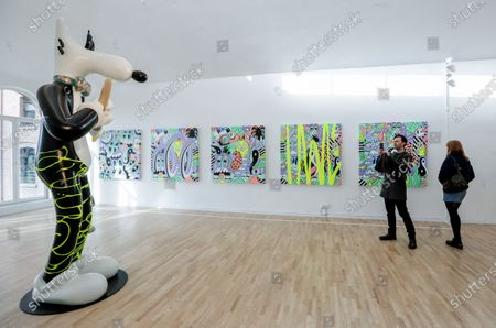 Visitors look at artworks by US artist Steven Harrington as part of the exhibition 'ZOO' at the MIMA Museum in Molenbeek, Brussels, Belgium, 14 February 2020. The exhibition runs until 20 August 2020.