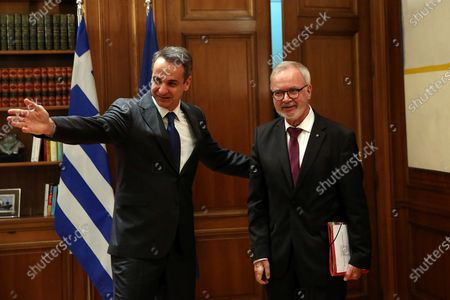 Greek Prime Minister Kyriakos Mitsotakis (L) welcomes President of the European Investment Bank (EIB) Werner Hoyer (R) during their meeting in Athens, Greece, 14 February 2020. Werner Hoyer is in Athens on a working visit.