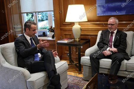 Greek Prime Minister Kyriakos Mitsotakis (L) talks with President of the European Investment Bank (EIB) Werner Hoyer (R) during their meeting in Athens, Greece, 14 February 2020. Werner Hoyer is in Athens on a working visit.