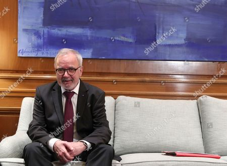 President of the European Investment Bank Werner Hoyer speaks during his meeting with Greek Prime Minister Kyriakos Mitsotakis, in Athens, on