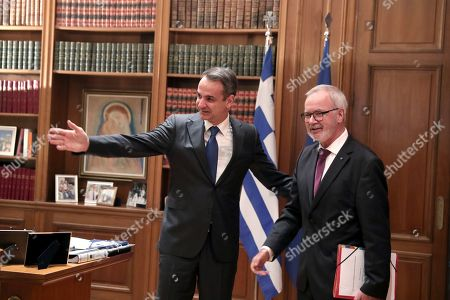 Kyriakos Mitsotakis, Werner Hoyer. Greek Prime Minister Kyriakos Mitsotakis, left, welcomes President of the European Investment Bank Werner Hoyer during their meeting in Athens, on