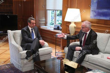 Kyriakos Mitsotakis, Werner Hoyer. Greek Prime Minister Kyriakos Mitsotakis, left, listens to President of the European Investment Bank Werner Hoyer during their meeting in Athens, on