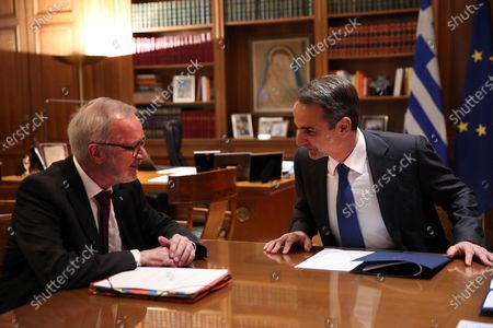 Greek Prime Minister Kyriakos Mitsotakis (R) talks with President of the European Investment Bank (EIB), Werner Hoyer (L) during their meeting in Athens, Greece, 14 February 2020. Hoyer is in Athens on a working visit.