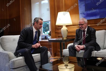 Greek Prime Minister Kyriakos Mitsotakis (L) talks with President of the European Investment Bank (EIB), Werner Hoyer (R) during their meeting in Athens, Greece, 14 February 2020. Hoyer is in Athens on a working visit.
