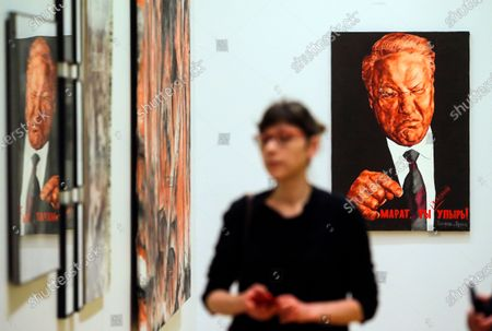 Stock Photo of A gallery worker walks in front the artwork 'Marat, you are a Greedy Ghoul' by Dmitry Vrubel and Viktoria Timofeeva depicting former Russian President Boris Yeltsin in the exhibition of works which Russian contemporary art collector and gallerist Marat Gelman donated to the State Tretyakov Gallery in Moscow, Russia, 14 February 2020. Gelman Gallery, one of the first private galleries in Moscow, was founded in 1990.