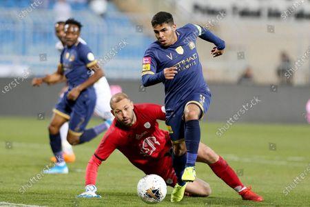 Al-Nassr's Yahya Al Shehri (R) in action against Al-Shabab's Farouk Ben Mustapha (L) during the Saudi Professional League soccer match between Al-Shabab and Al-Nassr at Prince Faisal bin Fahd Stadium, Al-Ridah, Saudi Arabia, 14 February 2020.